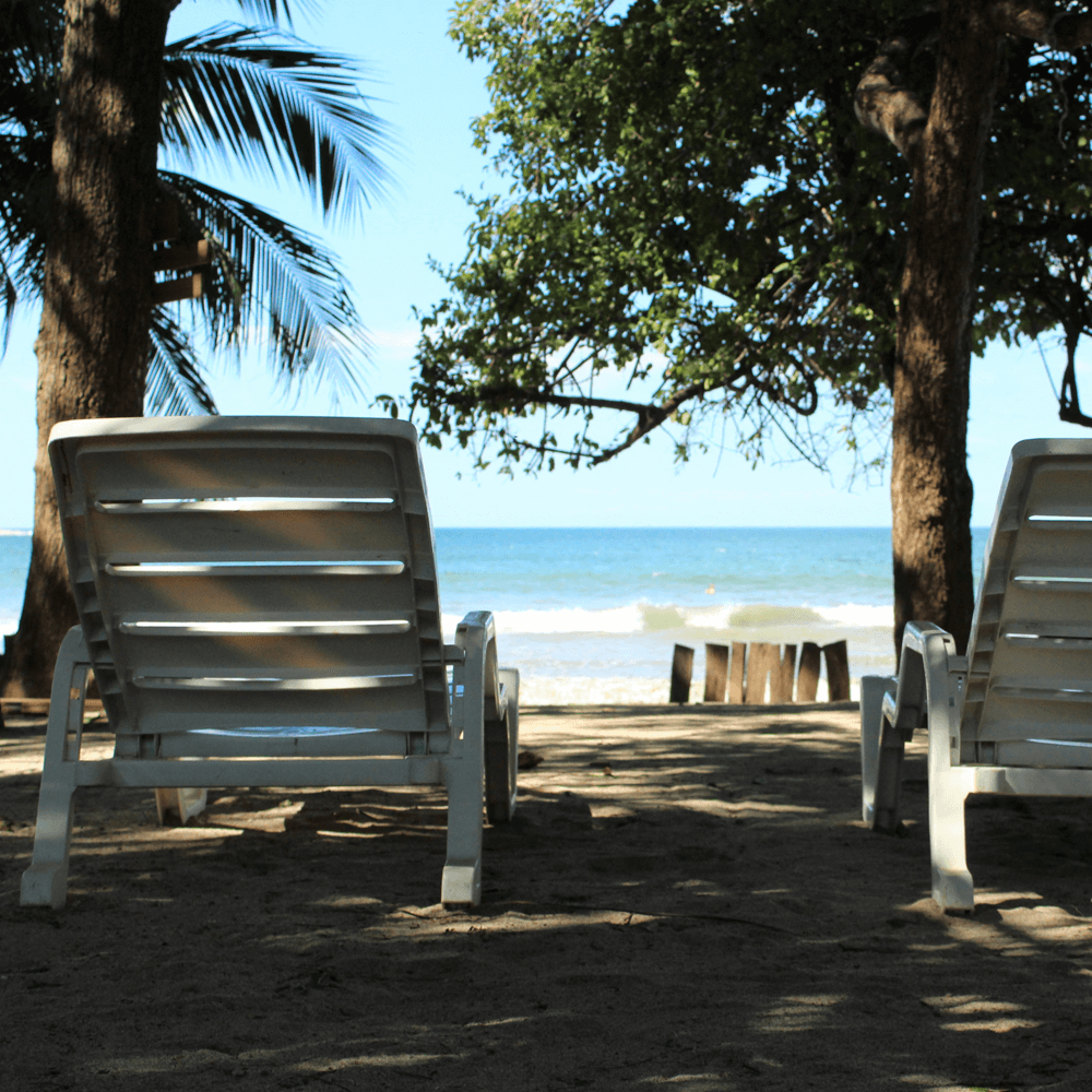 Shaded chairs overlooking the beach