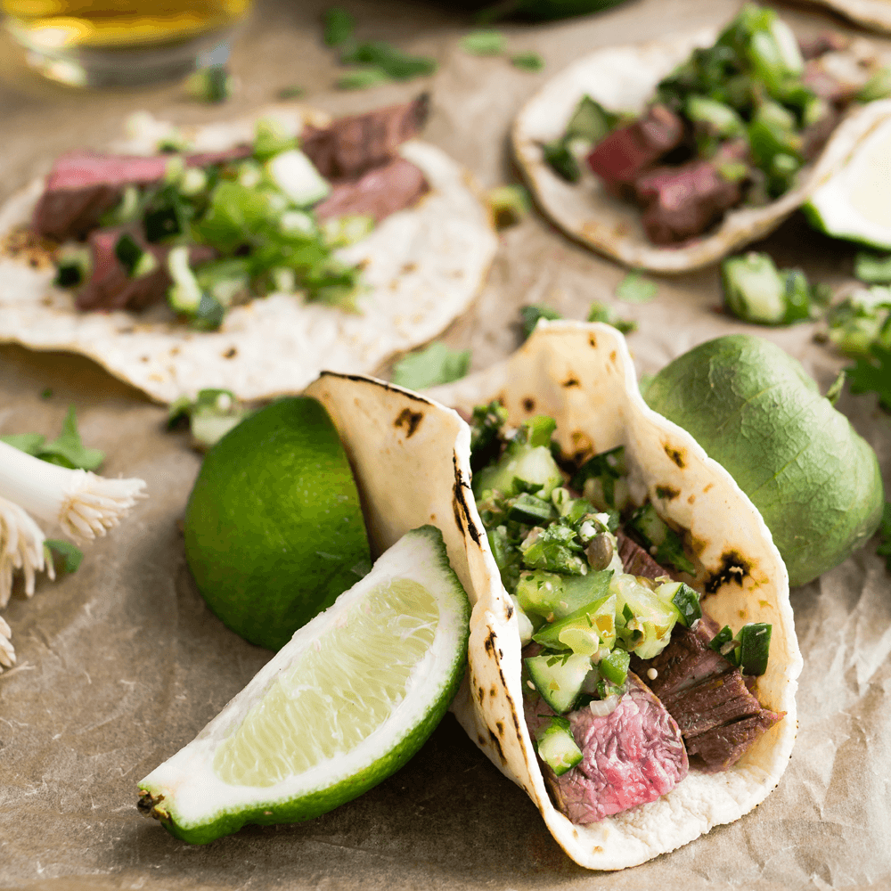 Tacos next to fresh limes