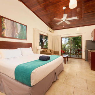 Bedroom and living area in the Beachfront Suites