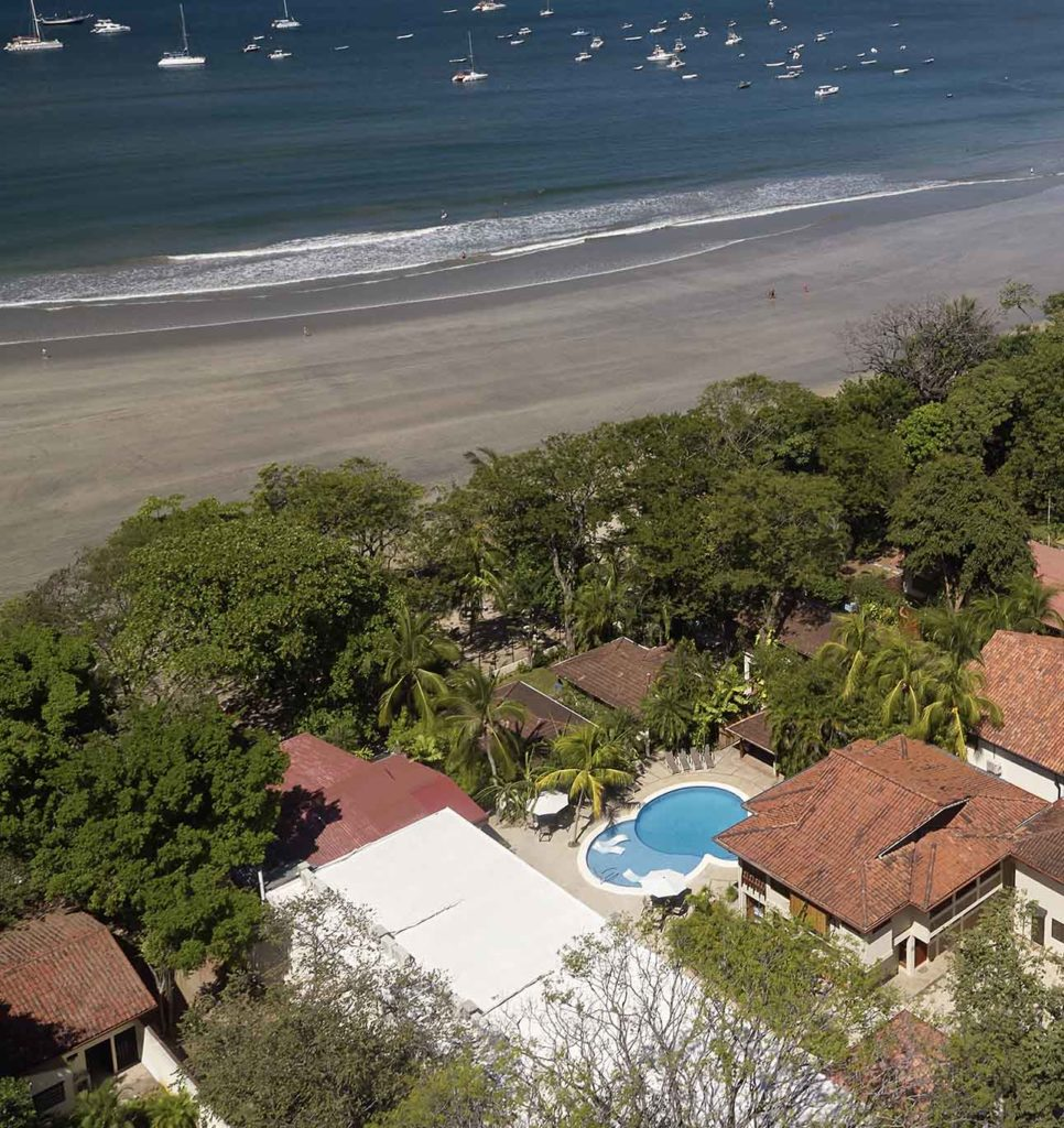aerial view of the hotel, pool, and beach front